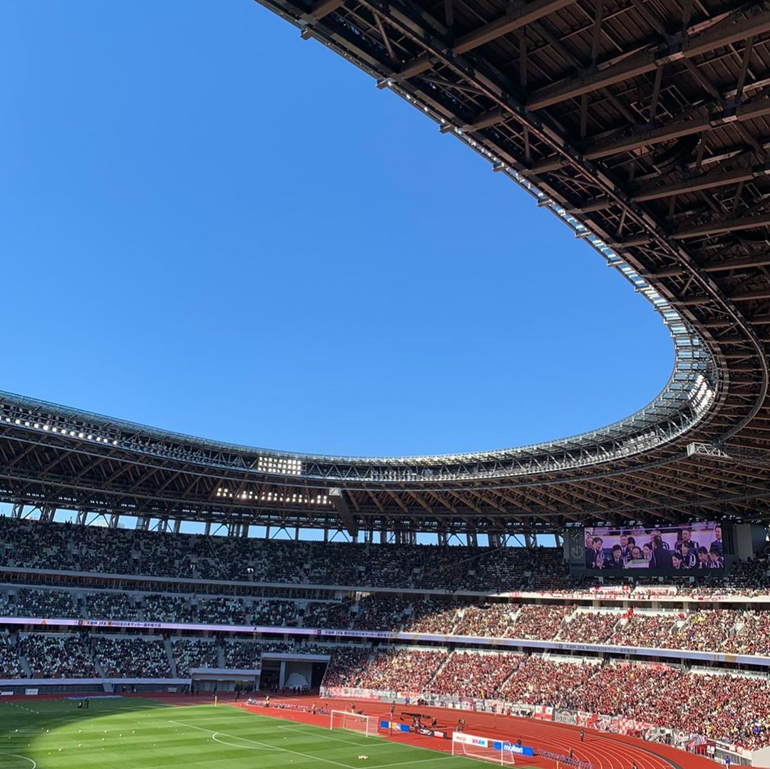 Soccer field of the national stadium seen from the audience