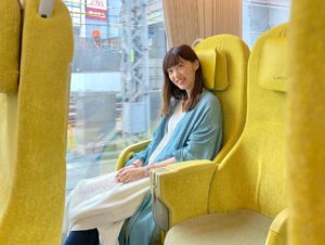 Woman sitting on Laview train